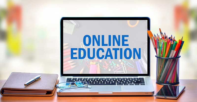laptop with text online education