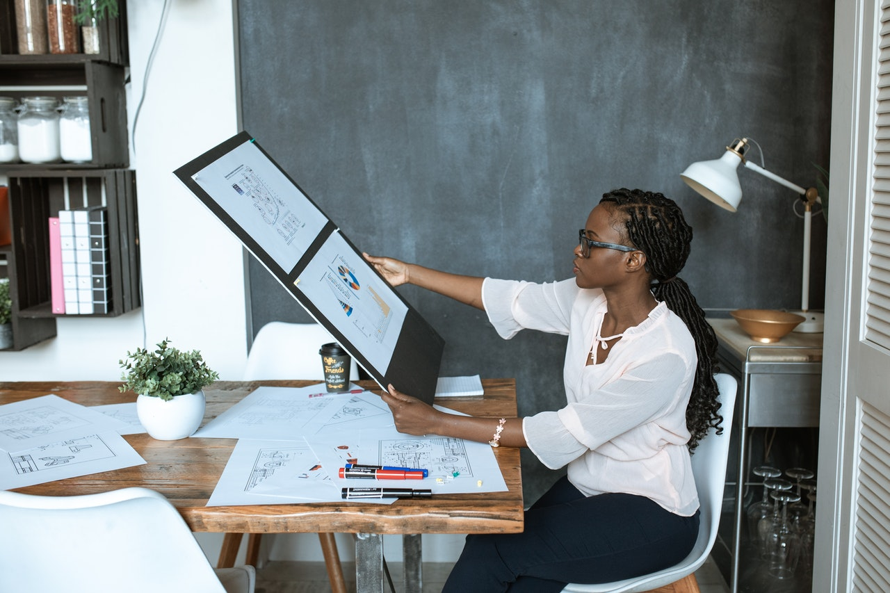 woman sitting at a table working on research output