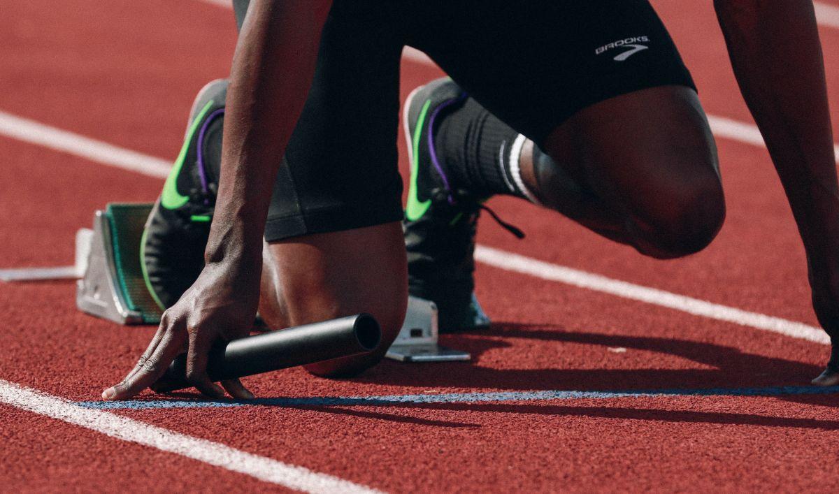 athlete before start on gravel track